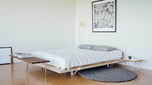 Floor Bed Frame Bedroom Beds With Storage White Bed Blue Quilt Wooden Floor