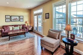 traditional living room with high ceiling hardwood floors in