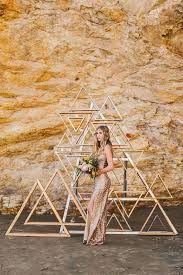 wedding backdrop trends metallic wooden triangle backdrop wedding party ideas 100