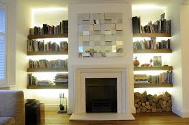 dwell modern gas fire places with tv and bookshelves there are