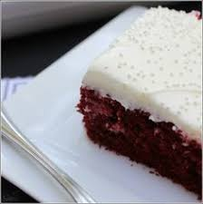 a red velvet cake poked with holes doused in sweetened condensed