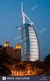 view at dusk of the burj al arab luxury hotel as seen from madinat