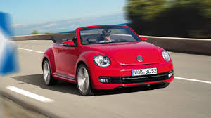 red volkswagen convertible first drive volkswagen beetle 1 2 tsi 2dr 2013 2014 top gear