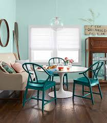 coastal dining room style with blue wall colors and mirror and