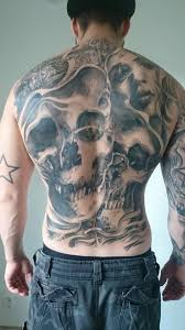 tattoo back face black and grey skulls and face tattoo on back