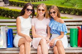 bench spectacles three beautiful girls in spectacles sitting on bench after