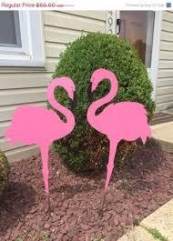 pink flamingos on a t rex cutouts pink flamingos