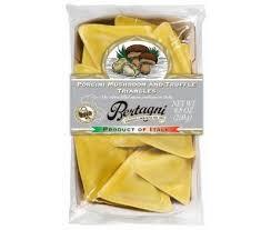 italian truffle cheese ravioli with pecorino and truffle in porcini mushrooms sauce