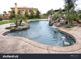 waterfall pool luxury backyard tropical landscaping stock photo