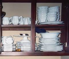 how do you arrange dishes in kitchen cabinets how to downsize and organize your kitchen whats cooking america