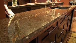 kitchen island with cooktop and seating granite countertop what is the best degreaser for kitchen