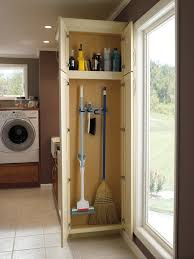 broom closet cabinet laundry room contemporary with blonde wood