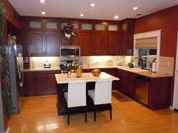Kitchen Remodeling Ideas On A Budget Cherry Wooden Cabinet With Beige Ceramic Backsplash For Small