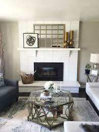 gold spike mirror in living room love the tufted ottoman for