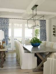 Coastal Dining Room With Beachy Blue Dining Chairs HGTV - Coastal dining room