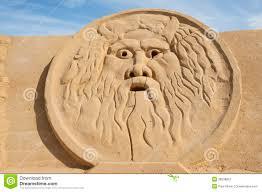 sand sculpture of greek god zeus royalty free stock photography