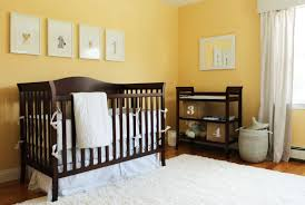 baby nursery neutral nursery features dark wooden crib with white