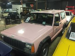 old parked cars 1986 jeep in the pink 1986 jeep cherokee