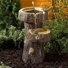 solar powered tree trunk birdbath by kaleidoscope