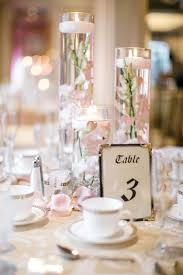table centerpieces with candles floating candle centerpieces with blush orchids and rose gold