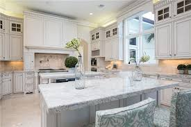 Granite Countertops With White Kitchen Cabinets by 30 Beautiful White Kitchens Design Ideas Designing Idea