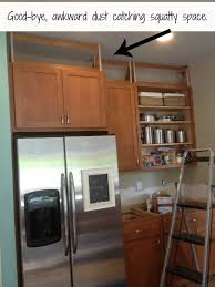 above kitchen cabinet storage ideas filling in that space above the kitchen cabinets