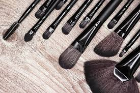 makeup artist tools professional tools of makeup artist on shabby wooden surface stock