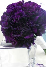 purple carnations purple variegated carnations and grass bouquet wedding flower