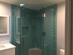 stylish tile shower and shower shelf with frameless glass door