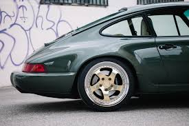 porsche 911 dark green desert salvage porsche 964 the paddock