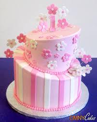 baby girl 1st birthday ideas pink topsy turvy 1st birthday cake cmny cakes