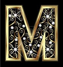 m gold letter with swirly ornaments stock photo for dd