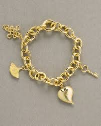 humanity bracelets h stern dvf charm bracelet in metallic lyst