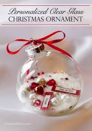 fill clear glass ornaments with sand and shells