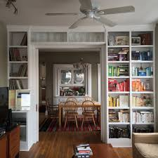 a full wall of shelves that accommodates for original built in