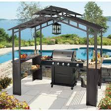 exterior modern outdoor kitchen appliance with dark hardtop