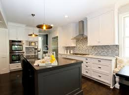 white kitchen cabinets with black island home decoration ideas