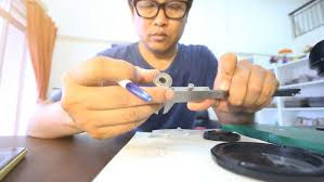 engineer to hand sketch design part and measuring bearing by