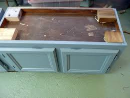 How To Paint A Filing Cabinet Upcycle Kitchen Cabinets Into A Storage Bench How Tos Diy