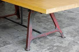 reclaimed dining table of antique machine bases and maple bowling
