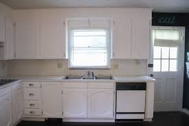 how to paint unfinished cabinets painting oak cabinets white an amazing transformation