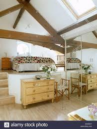 split level bedroom pine chest of drawers and mirrored wardrobe in split level bedroom