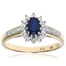 gold engagement rings uk naava sapphire and 12 set shoulders 9 ct yellow gold ring