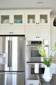 glass door kitchen cabinets with oil rubbed bronze pulls and upper