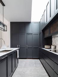 Cost To Paint Kitchen Cabinets Professionally by Elegant Black Cabinets Paint And White Marble Countertop