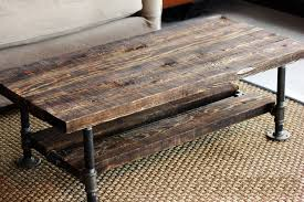 wood and pipe table reclaimed burned wood pipe coffee table rustic living room