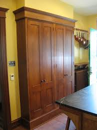 wall cabinets on floor what is being stored behind the tall floor to ceiling wall cabinets