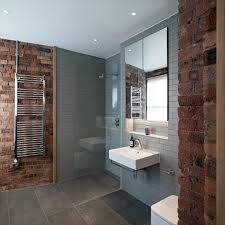 impressive subway tile in shower with exposed brick wet rooms
