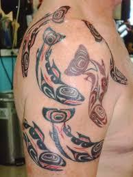 austin texas developer with a tattoo of a salmon crest design
