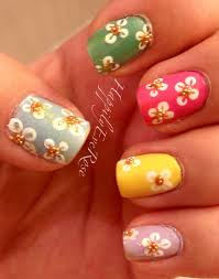 spring flower nail art design using pastel colors and micro beads